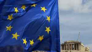 A European Union flag is seen in front of the Parthenon temple in Athens, Feb. 21, 2012.