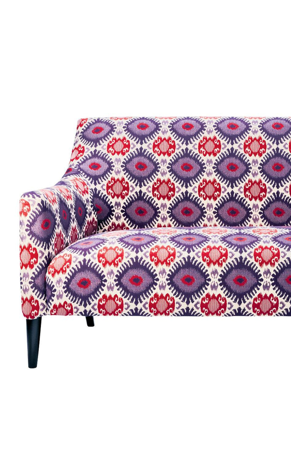 A vividly patterned settee makes a striking focal point. Settee, $500 at HomeSense (www.homesense.ca).