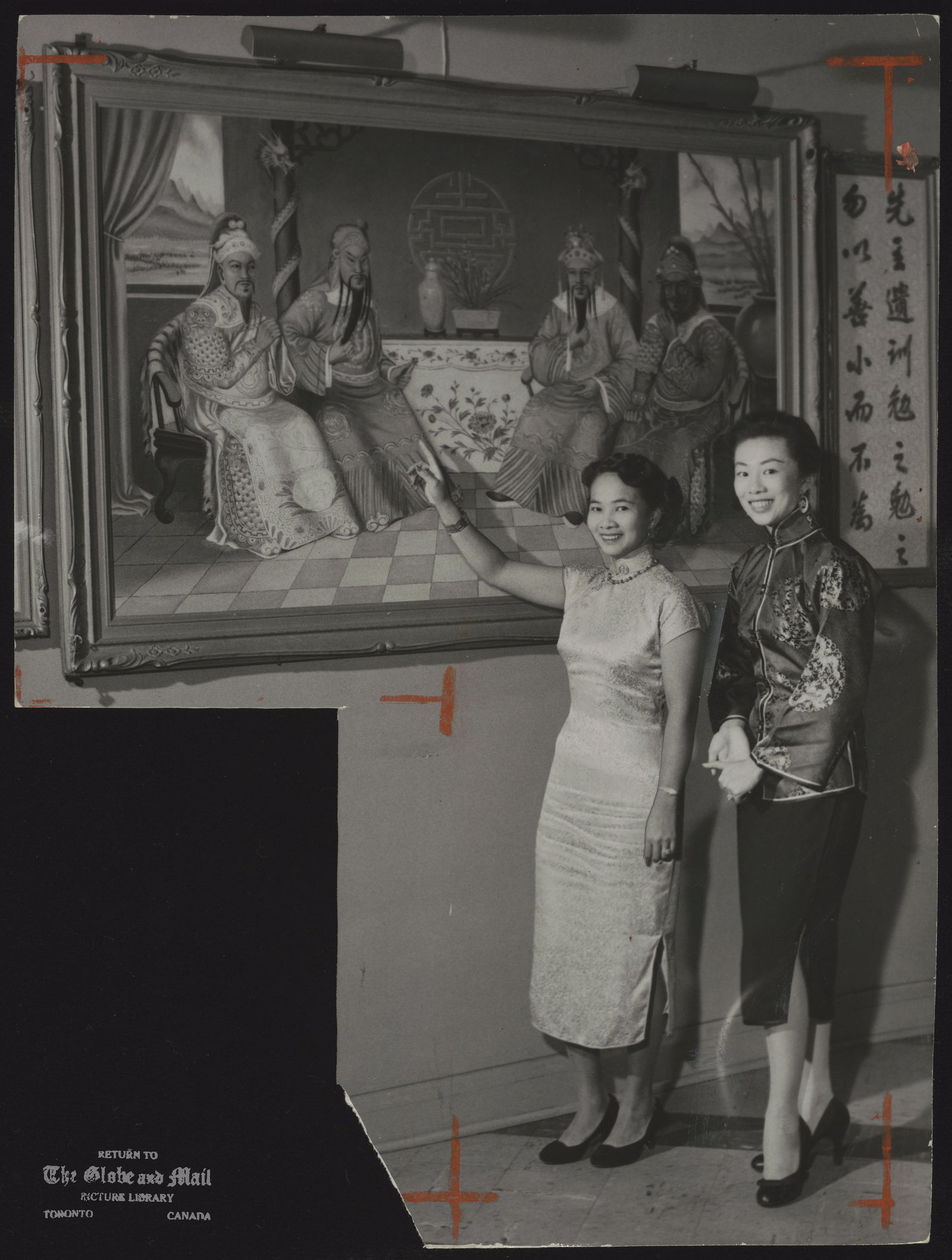 Chinatown (Toronto) Guides Mrs. Barbara Mark (left) and Mrs. Louise Mark show a portrait of representatives of the Lew, Quan, Chong and Chu families. The painting, rarely seen by persons other than Chinese, hangs in the Lon Kong Association hall.