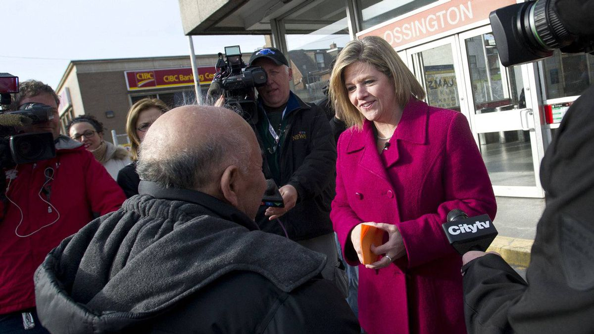 NDP Leader Andrea Horwath discusses Ontario's budget with a group of people in Toronto.