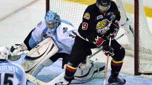 Owen Sound Attack forward Andrew Fritsch tries to get a shot on Mississauga St. Michael's Majors goalie J.P. Anderson (L) during the first period of their Memorial Cup round-robin ice hockey game in Mississauga May 25, 2011.