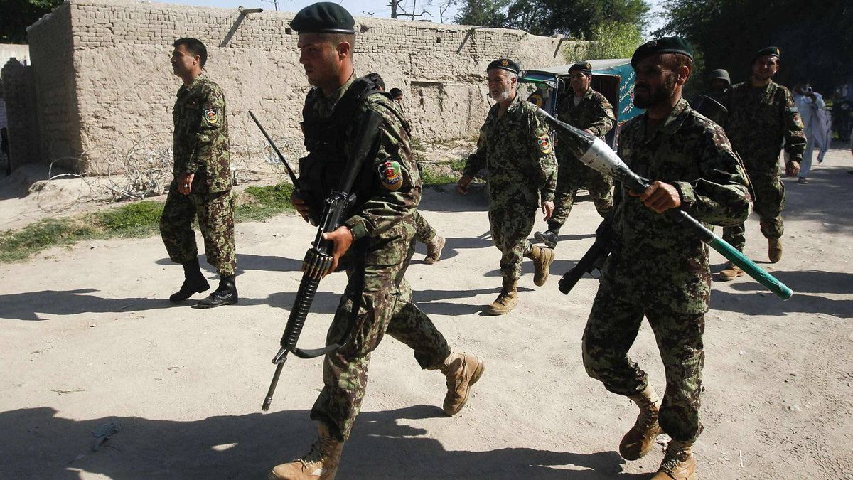 Afghan National Army soldiers arrive at the Provincial Reconstruction Team after gunmen launched a coordinated attack in Jalalabad province April 15, 2012.