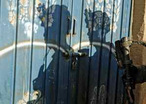 U.S. Marines knock at the door of a shop while conducting searches in Helmand province on April 23, 2010.