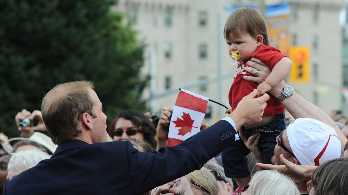 The Duke of Cambridge shakes the hand of a small child as he and the dutchess take part in a ceremony at the National War Memorial in Ottawa on Thursday, June 30, 2011.