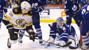 Toronto Maple Leafs goalie Jonas Gustavsson looks at the puck in the net after Boston Bruins' Jordan Caron lifted it past him in the first period.