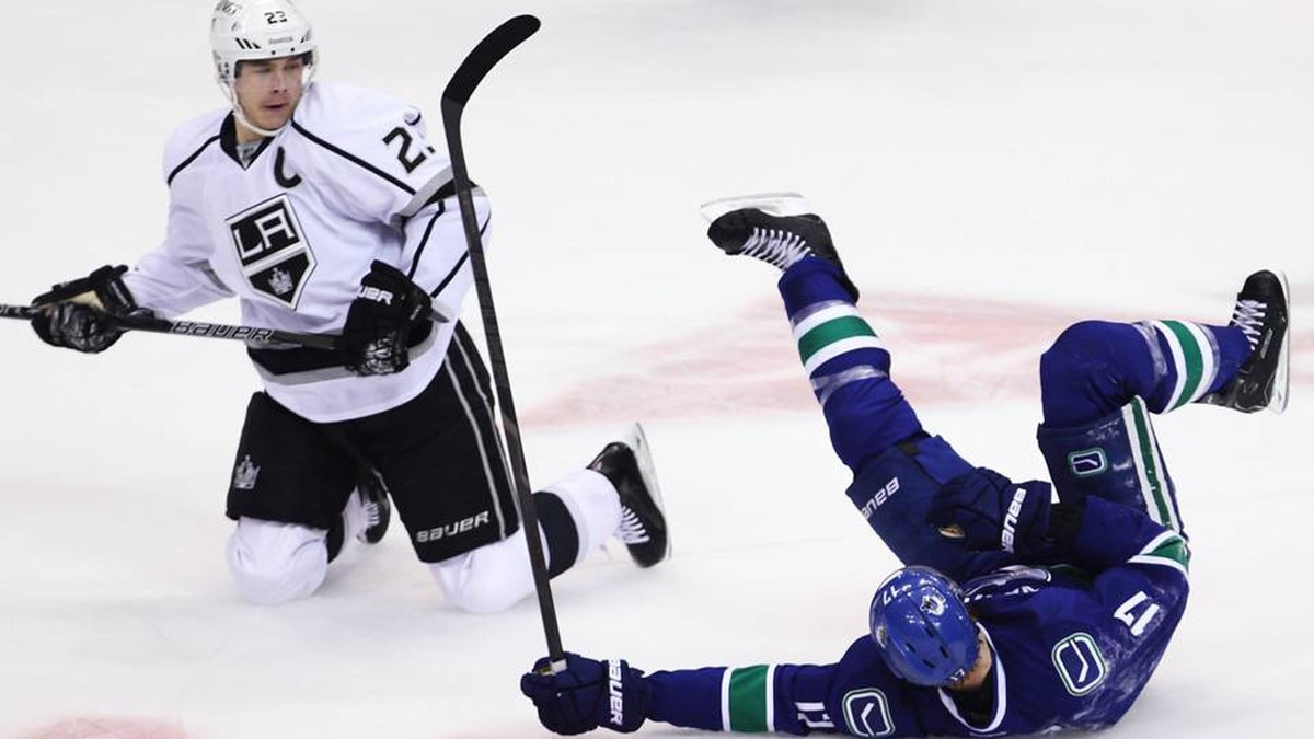 Vancouver Canucks center Ryan Kesler (17) and Los Angeles Kings right wing Dustin Brown (23) collide during first period NHL Stanley Cup playoff hockey action at Rogers Arena in Vancouver, B.C. Wednesday.