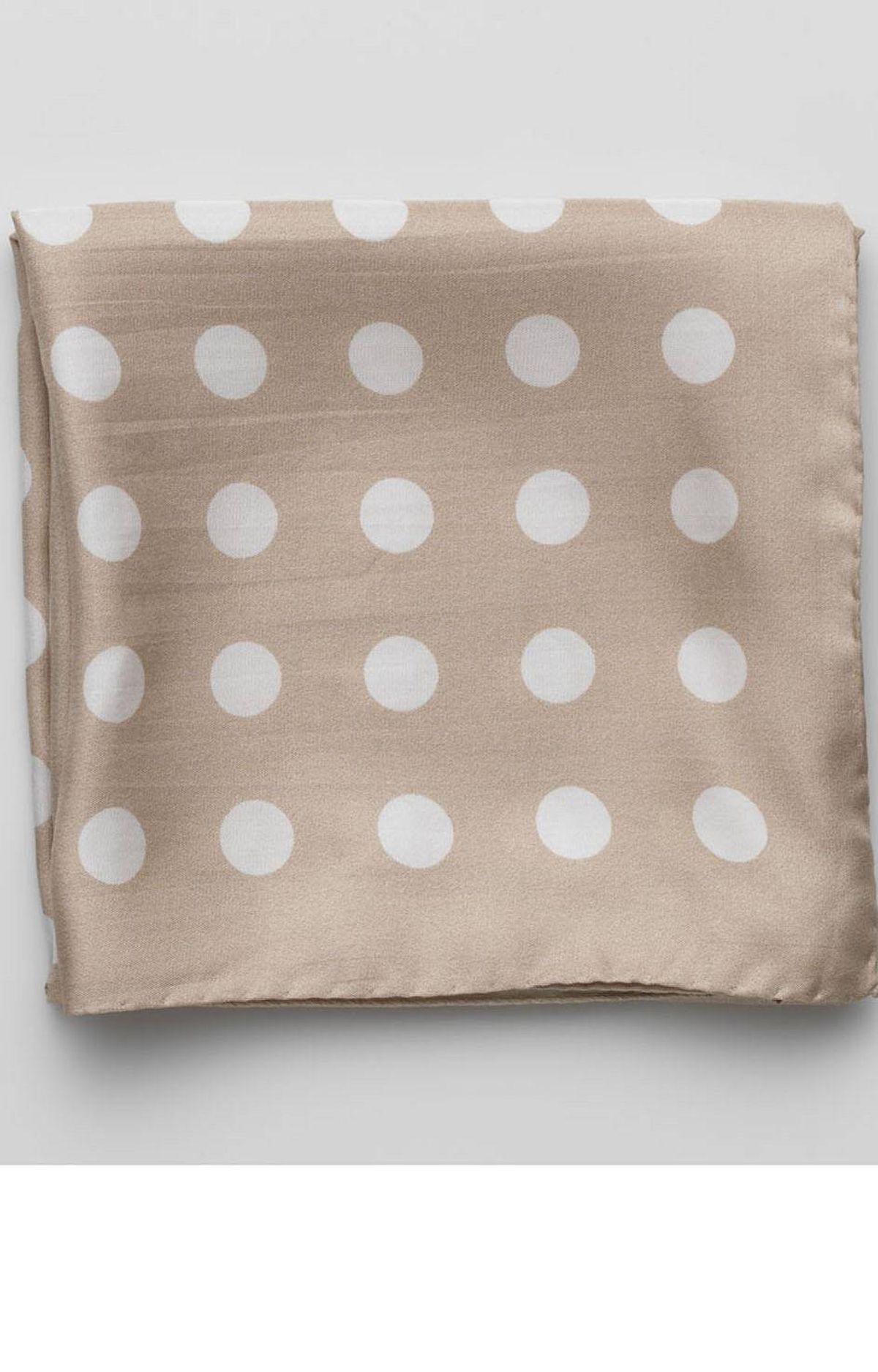 Silk scarf by Sand, $98 through 416-636-9190.
