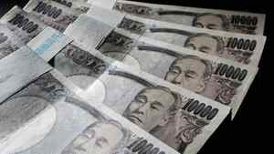 Japanese 10,000 yen bank notes are spread out at an office of World Currency Shop in Tokyo.