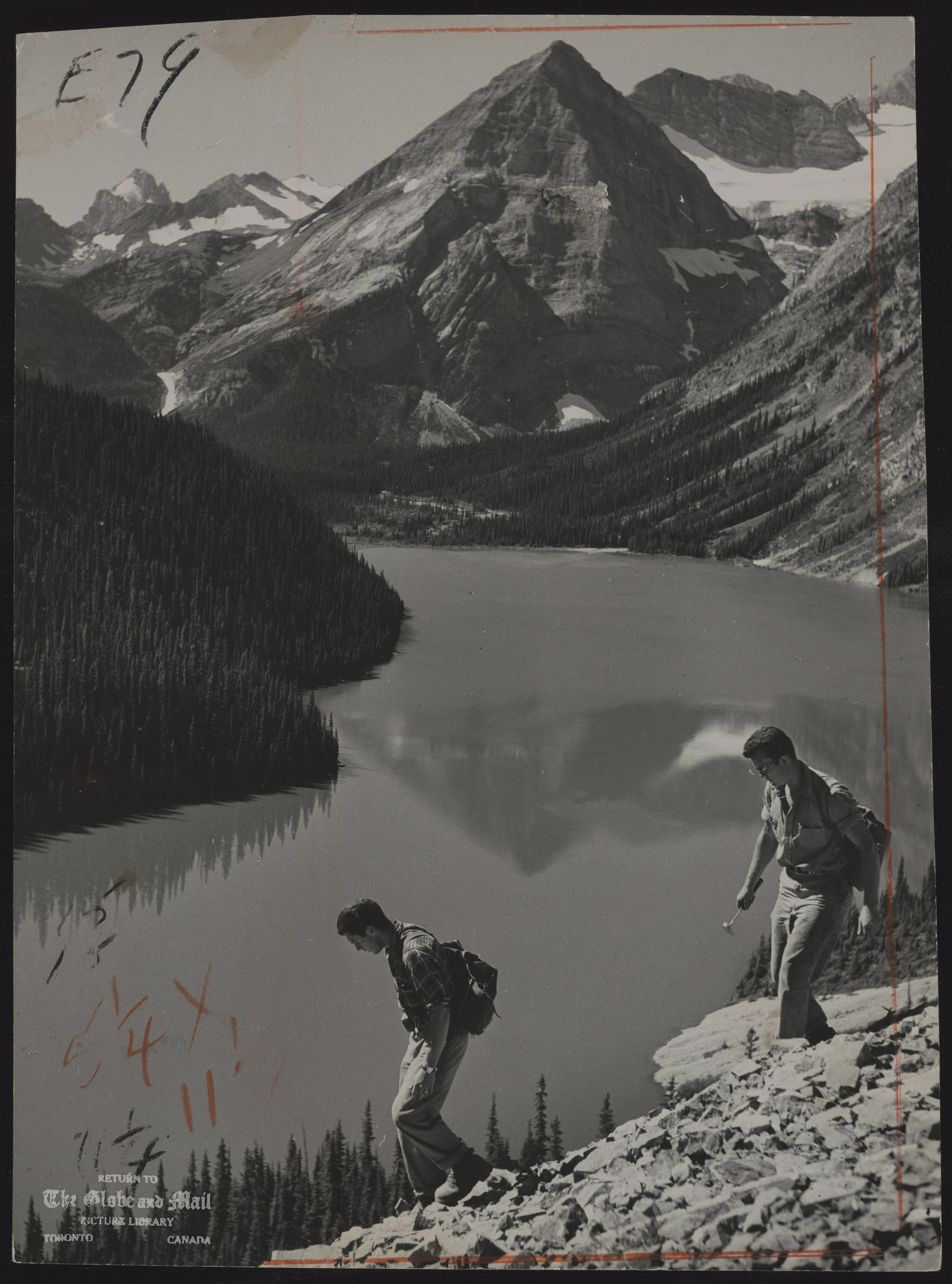 The notes transcribed from the back of this photograph are as follows: The Big, Broad Land. Geologists scale Rockies for clues to minerals, oil or gas deposits. Originally published July 1, 1959.