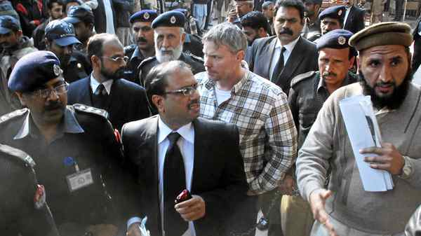 U.S. consulate employee Raymond Davis is escorted out of courtin Lahore on Jan. 28, 2011. Mr. Davis, jailed for shooting two Pakistanis, is shielded by diplomatic immunity.