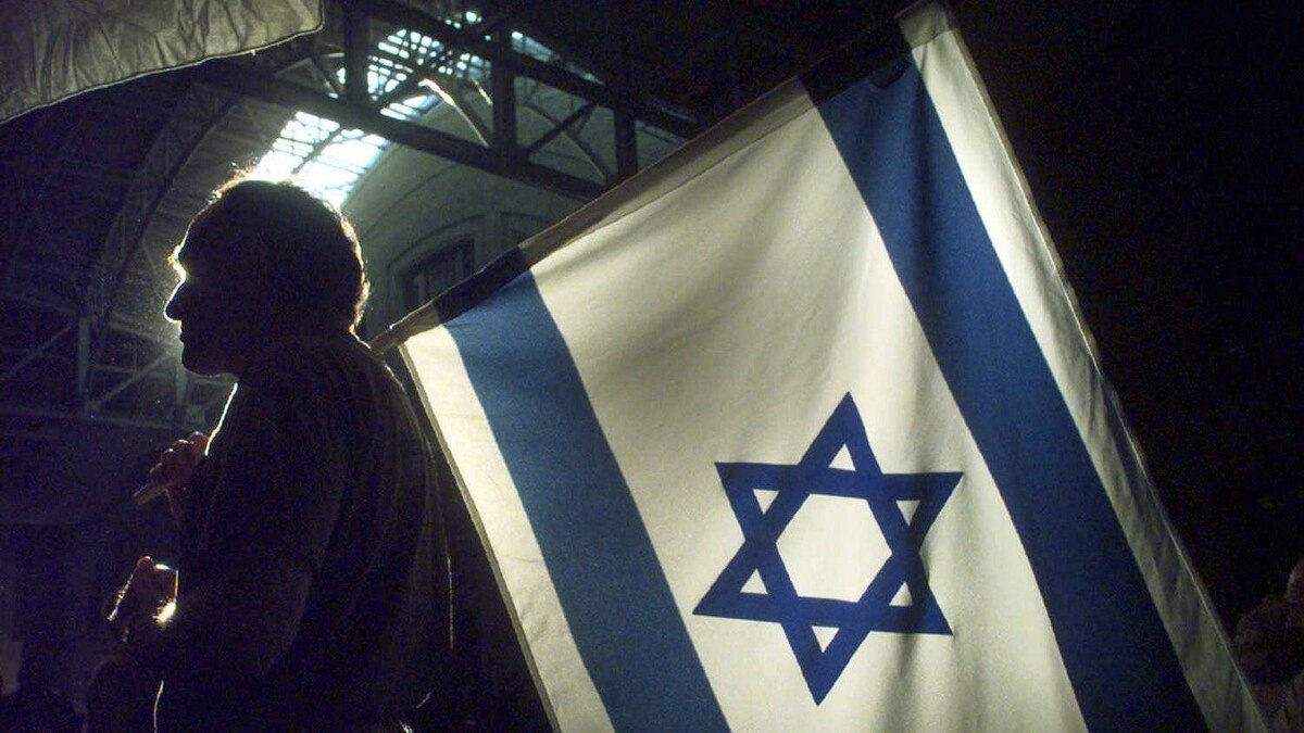 The Israeli flag flies at a Toronto conference centre during celebrations marking the Jewish state's 50th birthday on April 30, 1998.