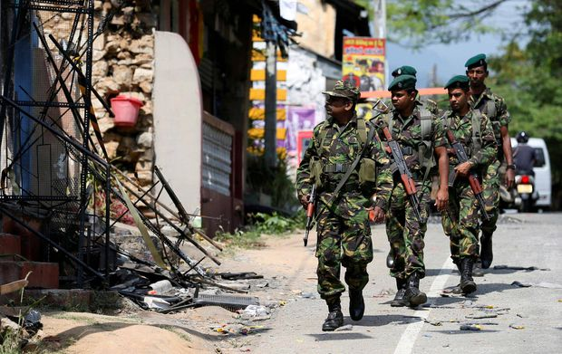 Buddhist mobs sweep through Sri Lanka's Muslim neighbourhoods