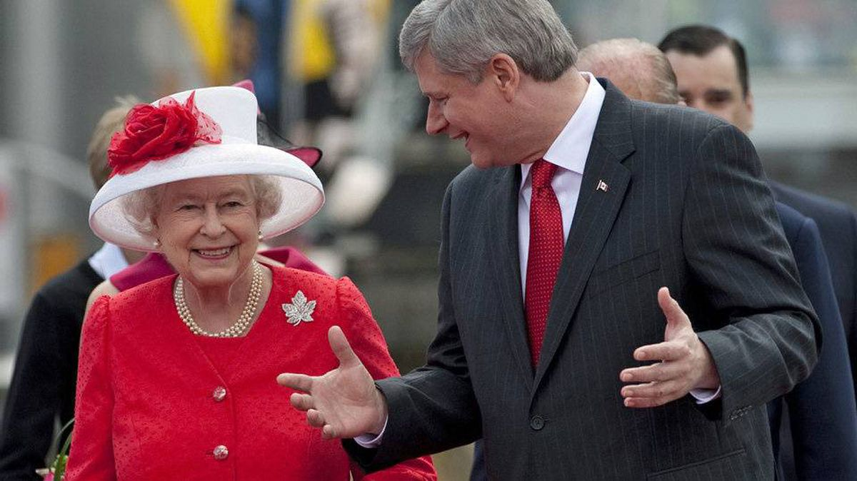 The Queen speaks with Prime Minister Stephen Harper as they arrive for Canada Day celebrations on Parliament Hill on July 1, 2010.