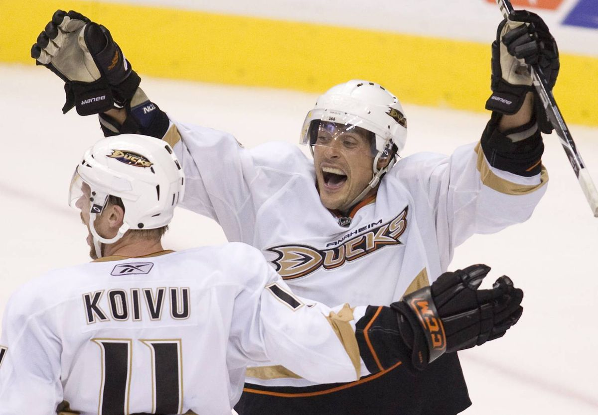 Anaheim Ducks sniper Teemu Selanne, right, celebrates his game-winning overtime goal with teammate Saku Koivu, left, against the Vancouver Canucks during preseason NHL action at GM Place in Vancouver, Thursday, Sept. 24, 2009. The Ducks won the game 3-2.