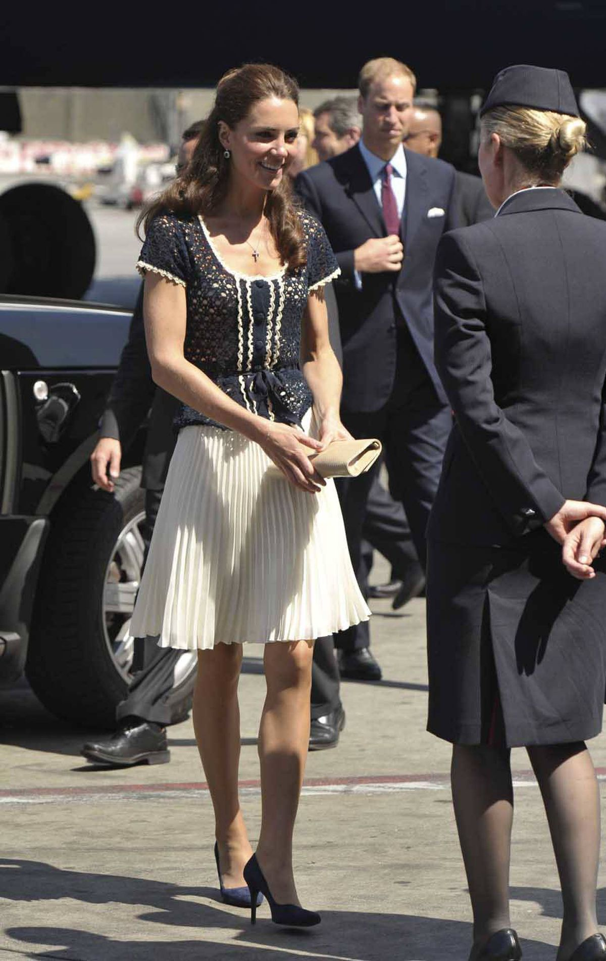 Kate departs Los Angeles on July 10 wearing an outfit from Whistles, a high street chain.