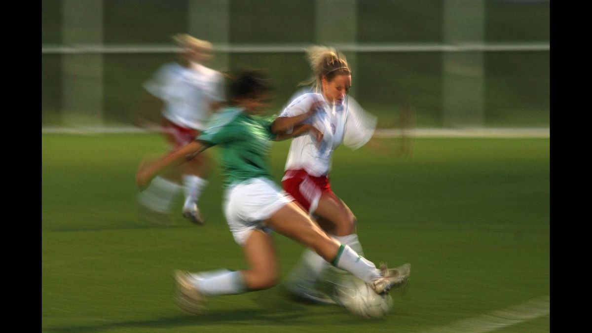 This soccer action photo was shot at 1/15th of a second. The face of the player in white is moving very little and appears relatively sharp. Everything else is moving and will blur across the focal plane at such a slow shutter speed.