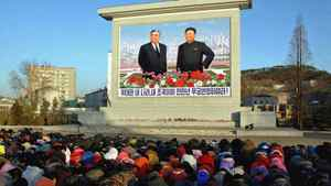 North Koreans mourn in front of a large portrait of Kim Jong Il and his father, Kim Il Sung, in a photo distributed Dec. 19, 2011 by the official Korean Central News Agency.