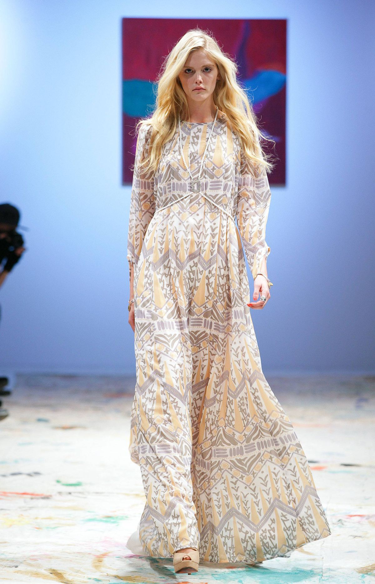 It was the custom prints, however, that were the true champion in this collection. They were best showcased in the piece de resistance: a long-sleeved maxi in a subtle, neutral palette that floated down the runway.