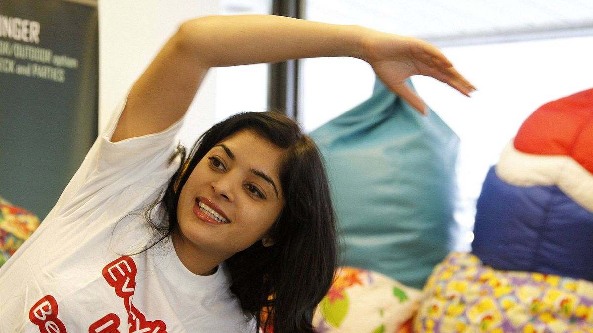 Anupama Vittal, CEO of the Bean Bag Factory Inc., stretches as part of her rehab routine after injuring her knee.