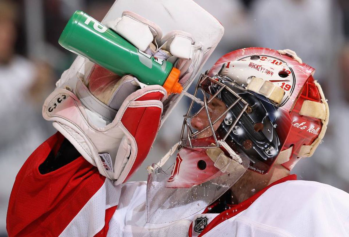 Goaltender Jimmy Howard #35 of the Detroit Red Wings sprays water in his face in Game Two of the Western Conference Quarterfinals against the Phoenix Coyotes during the 2010 NHL Stanley Cup Playoffs at Jobing.com Arena on April 16, 2010 in Glendale, Arizona. The Red Wings defeated the Coyotes 7-4 to tie the series at 1-1.