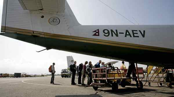 Tourists board a flight out of Tribhuvan Airport in Kathmandu.