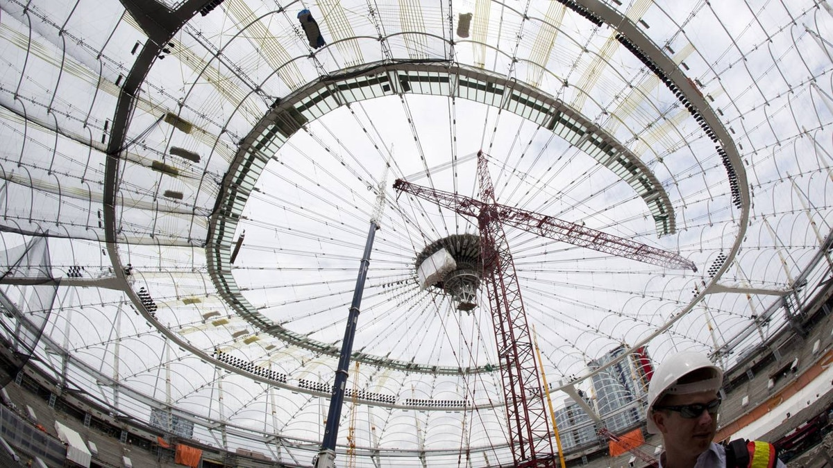 Members of the media during a tour of construction at BC Place in Vancouver June 28, 2011.