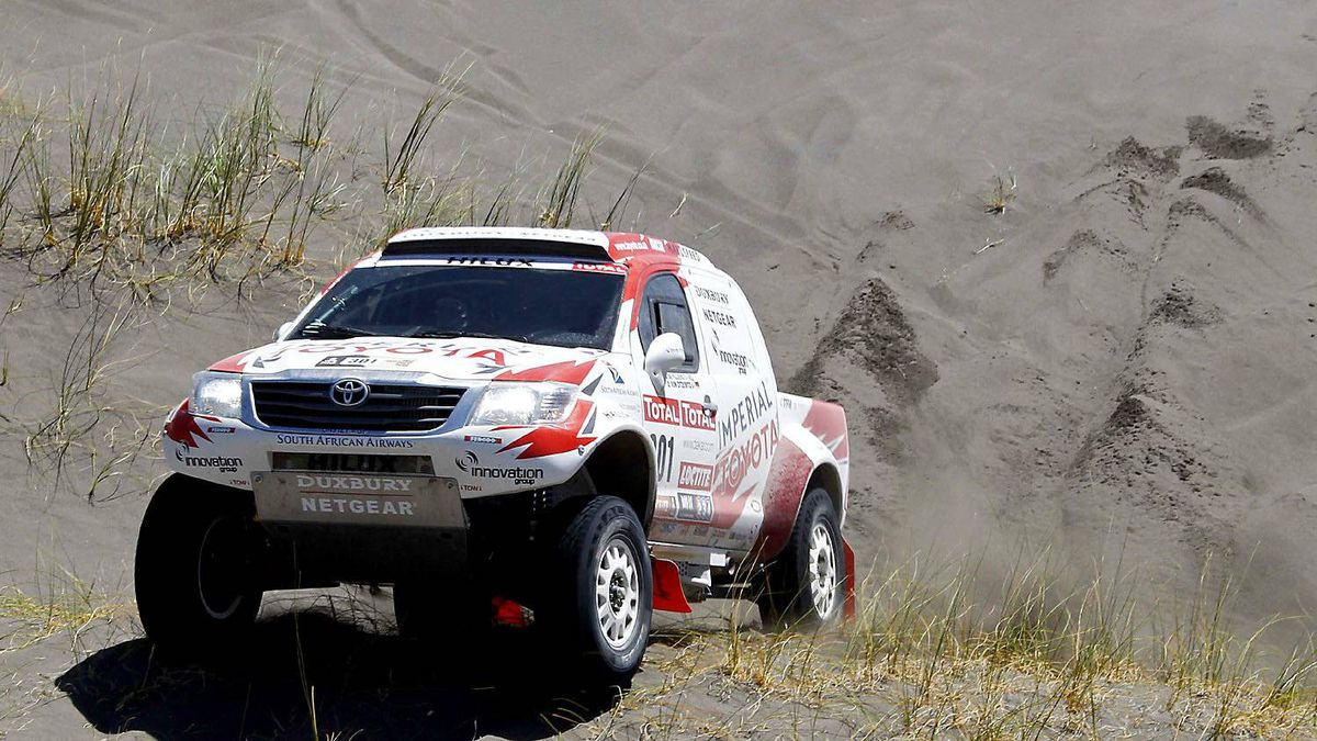 South Africa's Giniel De Villiers and co-pilot Germany's Dirk Zitzewitz drive their Toyota during the second stage of the fourth South American edition of the Dakar Rally 2012 from Santa Rosa de la Pampa to San Rafael January 2, 2012.