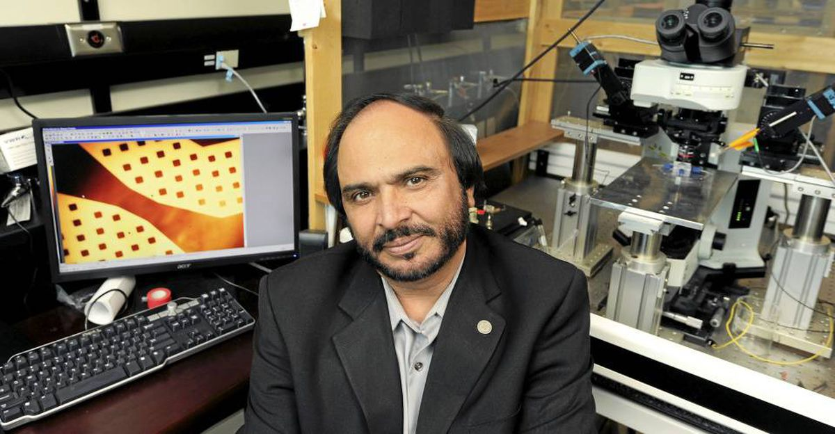 Dr. Naweed Syed in the lab at the University of Calgary's Health Sciences Centre.with an extreme close-up of the neurochip displayed on a computer screen.