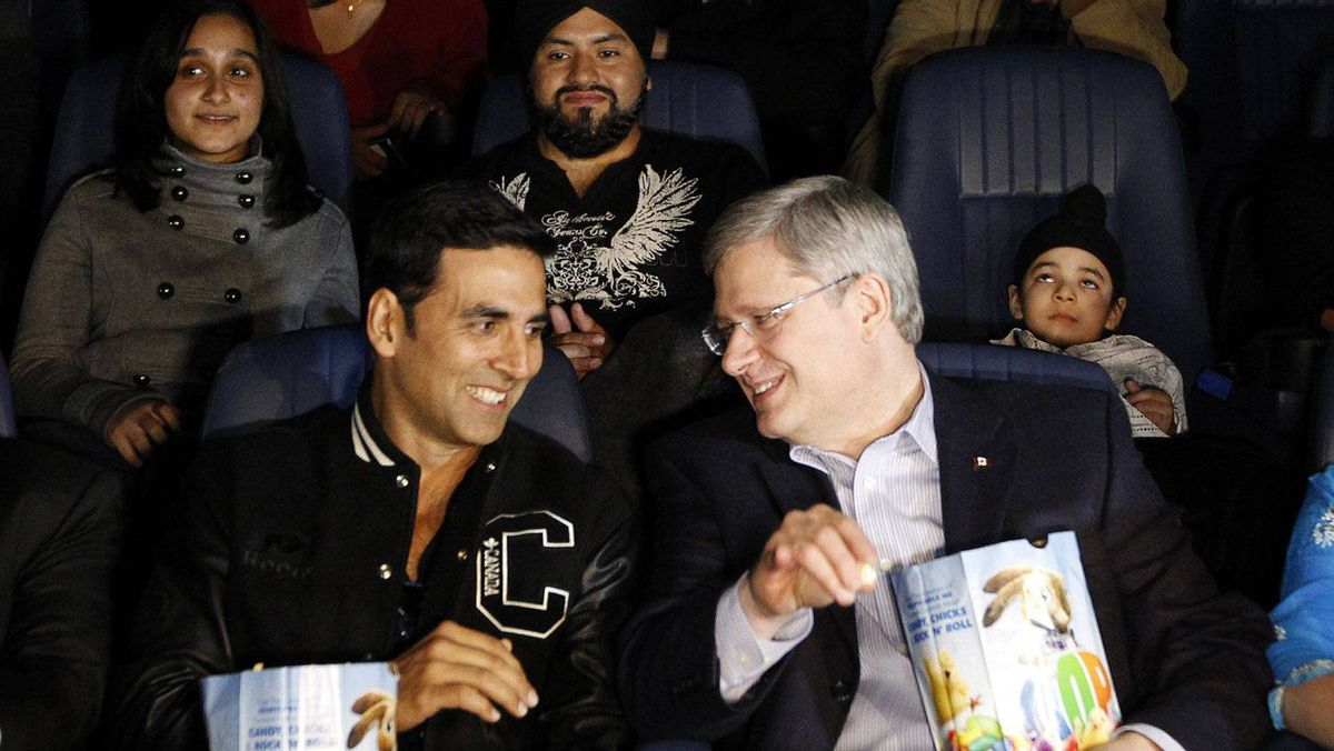 "Conservative leader and Canada's Prime Minister Stephen Harper (R) talks with Bollywood actor Akshay Kumar before the start of the Canadian premiere of Kumar's film ""Thank You"" during a campaign stop at a theatre in Brampton, Ontario April 8, 2011. Canadians will head to the polls in a federal election on May 2."