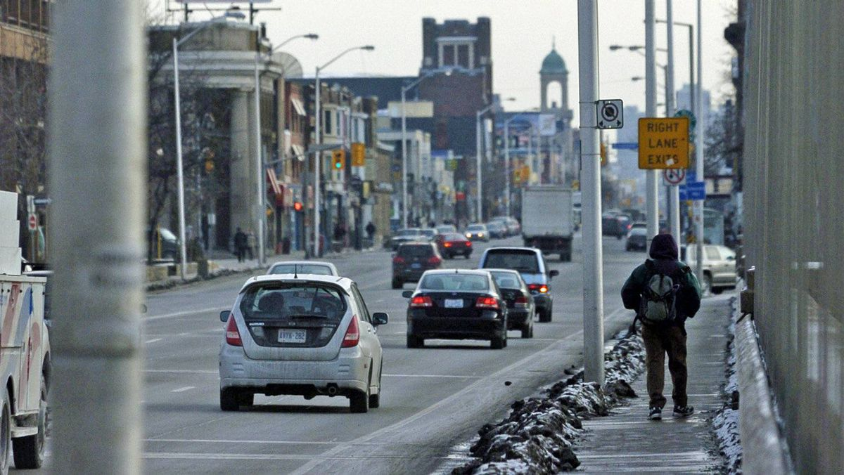 A pedestrian walks across the Bloor Street viaduct into Toronto's Danforth neighbourhood. The federal riding was held by NDP leader Jack Layton from 2004 until his death in August of 2011.