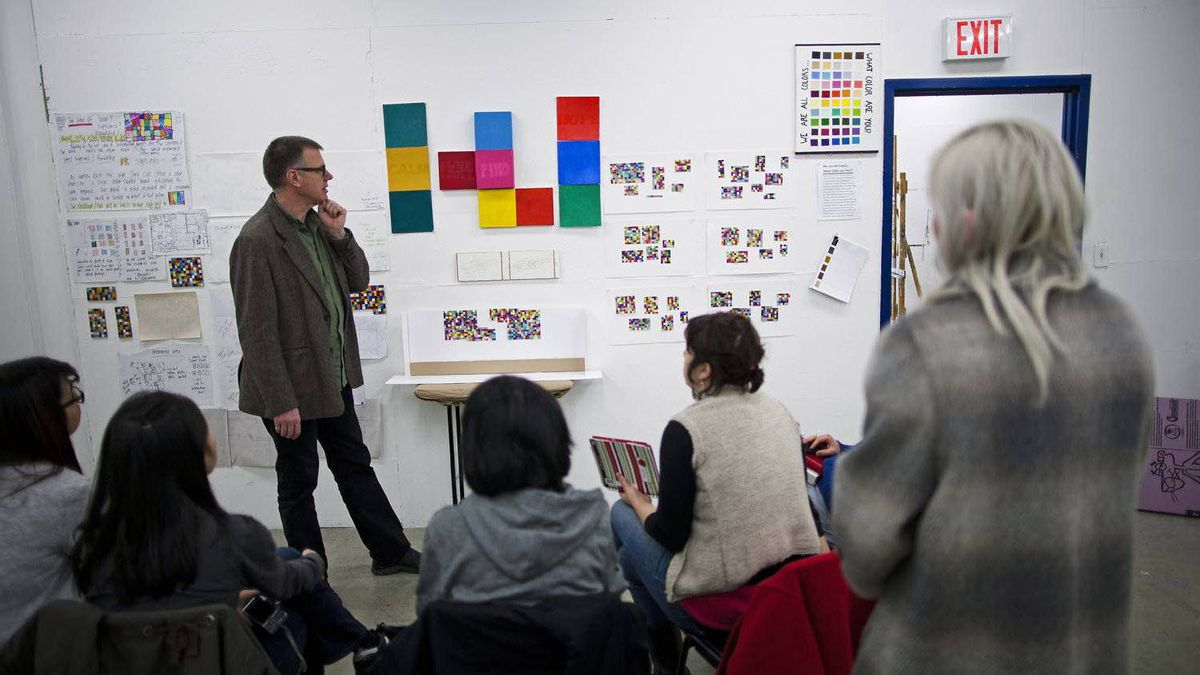 """David MacWilliam, Dean of the Faculty of Visual Art and Material Practice, views the Union Gospel Mission """"What Color are You?"""" project."""