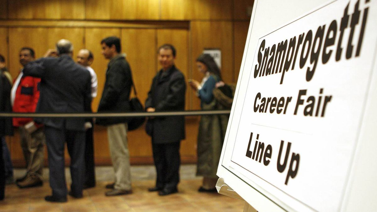 People attend a 2009 job fair in Calgary.