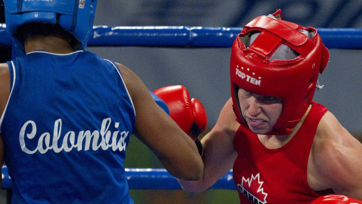 Canada's Mandy Bujold (R) and Colombia's Ingrid Valencia trade punches during the women's flyweight boxing finals at the Pan American Games in Guadalajara, October 29, 2011. Bujold won the gold while Valencia the silver. The games run through October 30. REUTERS/Andy Clark