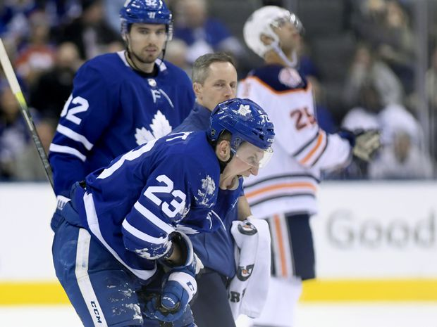 Toronto Maple Leafs defenceman Travis Dermott skates off injured with a  trainer during a game against the Edmonton Oilers in Toronto on Feb. 27 5e3496489