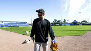Toronto Blue Jays infielder Adam Lind leaves the field after taking part in a early spring training session in Dunedin.