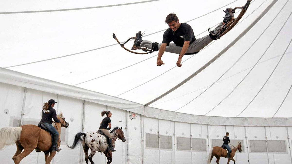 Acrobat Lucas Tormin-Mendonca soars through the air with the help of spring-loaded stilts during a warmup for Cavalia's Odysseo, a big-top horse and acrobatics extravaganza that premieres in Toronto on Tuesday, May 15.