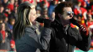 Country music duo Thompson Square perform the U.S. national anthem prior to the 2011 NHL Heritage Classic Game at McMahon Stadium on February 20, 2011 in Calgary, Alberta, Canada. (Photo by Mike Ridewood/Getty Images)