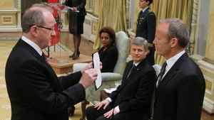 Stockwell Day is sworn in as President of the Treasury Board and Minister for the Asia-Pacific Gateway at Rideau Hall as Prime Minster Stephen Harper looks on in Ottawa on Tuesday, Jan. 19, 2010.