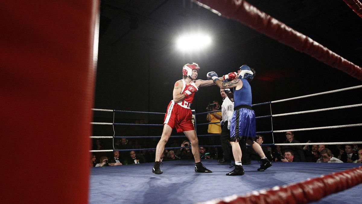 Liberal Member of Parliament Justin Trudeau (L) and Conservative Senator Patrick Brazeau fight during their charity boxing match in Ottawa March 31, 2012.