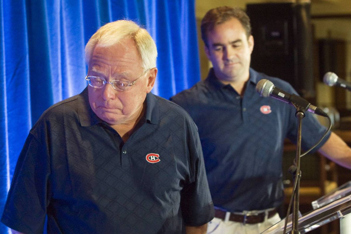 George Gillett, left, pauses to compose himself after announcing the sale of the Montreal Canadiens in September. Geoff Molson, the head of the new ownership group, looks on during a news conference before the team's celebrity golf tournament.