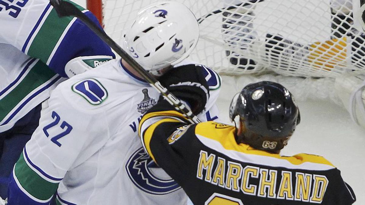 Boston Bruins forward Brad Marchand punches Vancouver Canucks forward Daniel Sedin during the third period in Game 6.