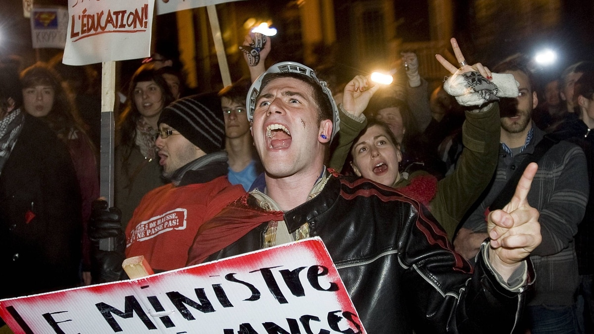 Students opposing tuition-fee hikes protest outside Quebec Premier Jean Charest's house in Montreal on Wednesday night.