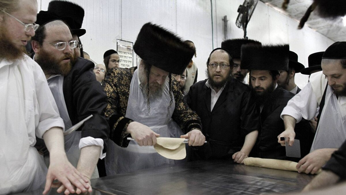 Orthodox Jews prepare special matzoh, a traditional handmade Passover unleavened bread at a bakery in before the Passover holiday in the port city of Ashdod, Israel, Friday, April 6, 2012.