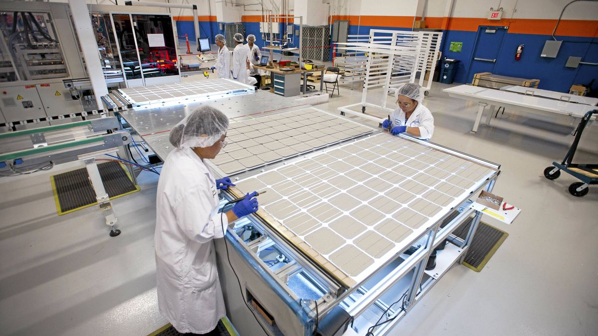 Workers at Silfab, an Ontario-based company specializing in photovoltaic technology, manufacture solar panels at a facility in Mississauga.