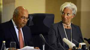 International Monetary Fund Managing Director Christine Lagarde (R) reacts next to South African Finance Minister Pravin Gordhan during a media briefing in Pretoria January 6, 2012.