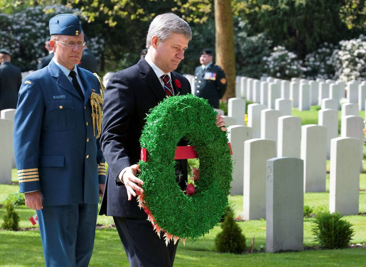 Prime Minister Stephen Harper lays a wreath at the memorial during a ceremony at the military cemetary in Bergen op Zoom Thursday May 6, 2010.