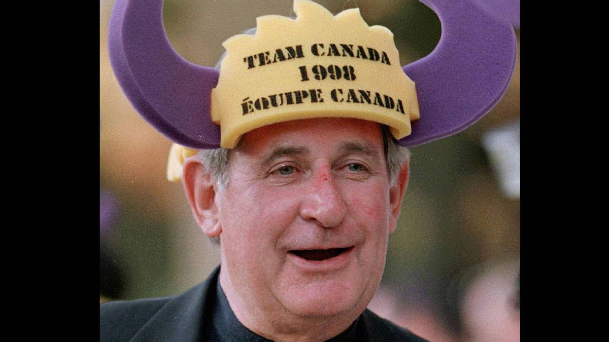 Mr. Klein wears a Team Canada hat given to him by Canadian businessmen in Santiago, Chile in 1998.