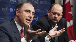 LSE CEO Xavier Rolet, left, and TMX Group CEO Tom Kloet speak to reporters in Toronto Feb. 9. 2011