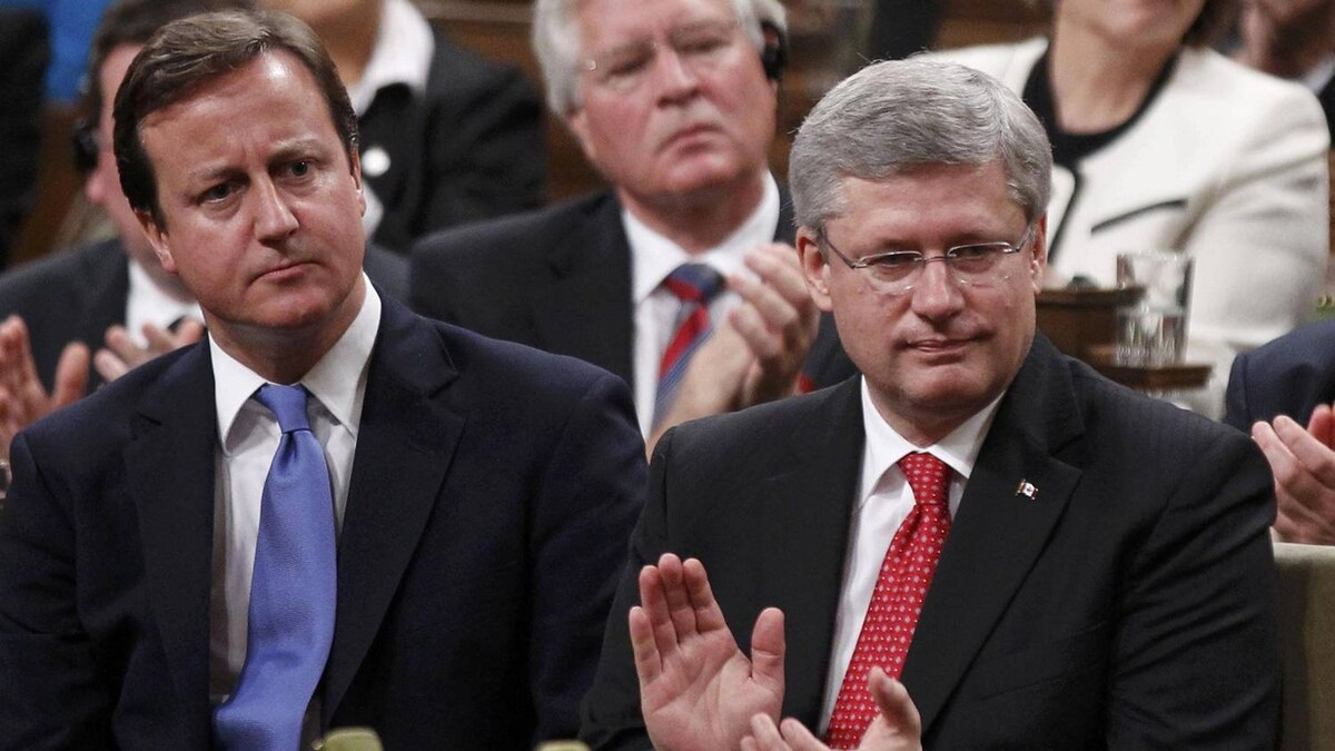 Britain's Prime Minister David Cameron sits with Canadian Prime Minister Stephen Harper after Mr. Cameron addressed a joint session of Parliament in Ottawa Sept. 22, 2011.
