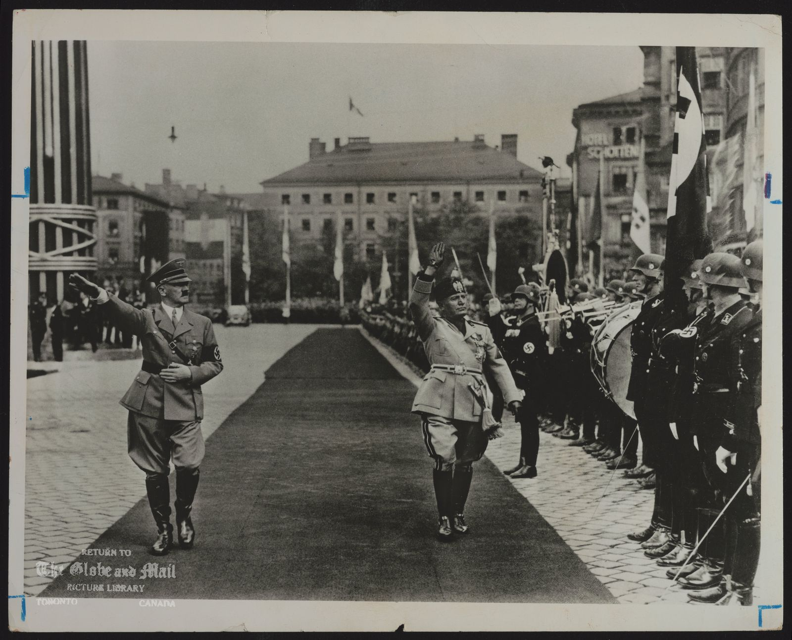 The notes transcribed from the back of this photograph are as follows: Benito MUSSOLINI Italy. Politician Hitler and Mussolini inspect a guard of honor in Munich in 1937